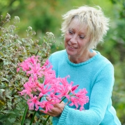 Carol Klein with Nerine 'Zeal Giant'